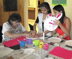 Edgewater Elementary School studetns Alexandra Hercules and Elsy Diaz-Ordonez work on Easter baskets with one of a resident of the South River Health & Rehabilitation Center.