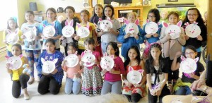 A group of students from Edgewater Elementary school show off their completed decorated baskets made from paper plates, which they made with residents of the South River Health & Rehabilitation Center.